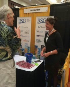 Cindy Hogan networks with a trade show attendee.